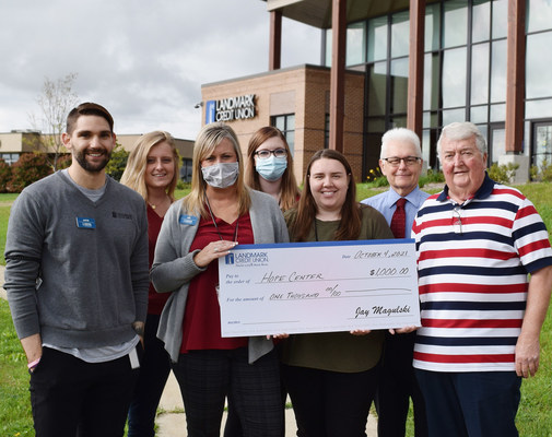 Landmark Credit Union celebrates the opening of its new Waukesha branch location by presenting the Hope Center with a $1,000 donation. Pictured from left to right are Justin Bethia, Caylee Perez, Jen Jackson, and Alexis Traxler from Landmark Credit Union, and Rebecca Arnold, Alden Luzi, and Ralph Zick from Hope Center.